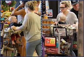 Hilary Duff has son Luca in a grocery cart cover.